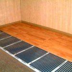 Инфракрасный теплый пол под ламинат: преимущества и особенности монтажа
